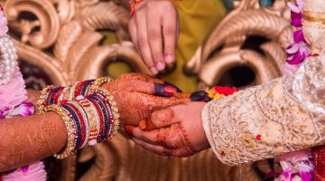 Indian Wedding hand holding