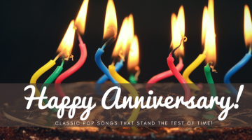 Happy Anniversary words and candles on chocolate cake