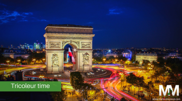L'arc de Triomphe and French flag by night