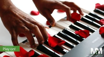 Hands on keyboard with rose petals - valentine music